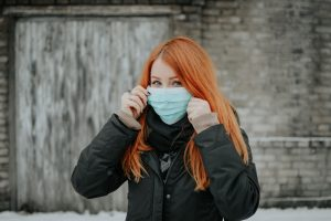 woman with COVID 19 face mask